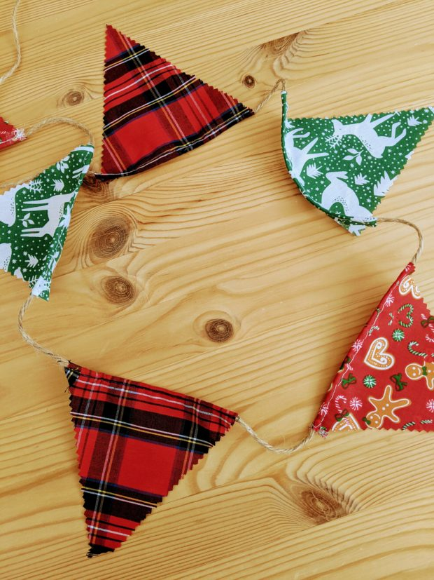 Christmas bunting laid out on a wooden table